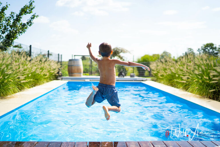 a boy jumping into a pool requires a fast shutter speed